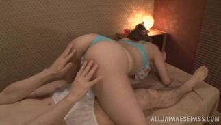 Playful girlfriend Reira Akane with huge tits strips lazily to show off her body