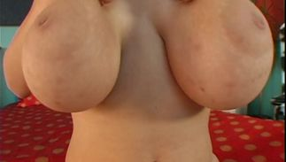 Seductive dark-haired Terry with massive tits shows her juicy gap