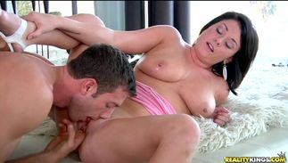 Playful bosomed Elle Ryan knows how to ride a fang wildly