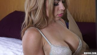 Cheerful maid Kylie Rogue with impressive tits eagerly gives the wet fellatio
